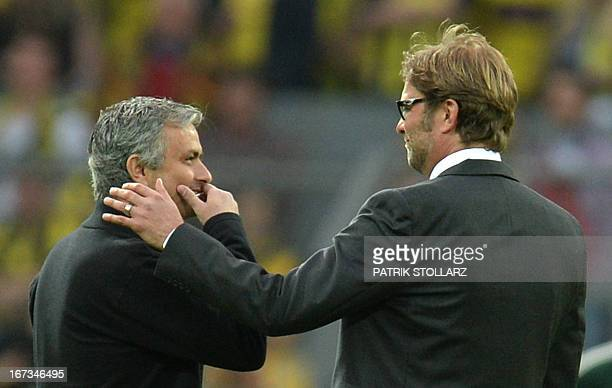 CROP Dortmund's head coach Juergen Klopp gestures towards Real Madrid's Portuguese coach Jose Mourinho prior to the UEFA Champions League semi final...