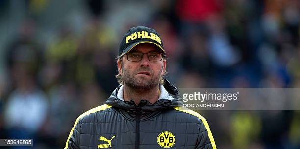 Dortmund's head coach Juergen Klopp oversees the warm u p session prior to the German first division Bundesliga football match Hannover 96 vs...