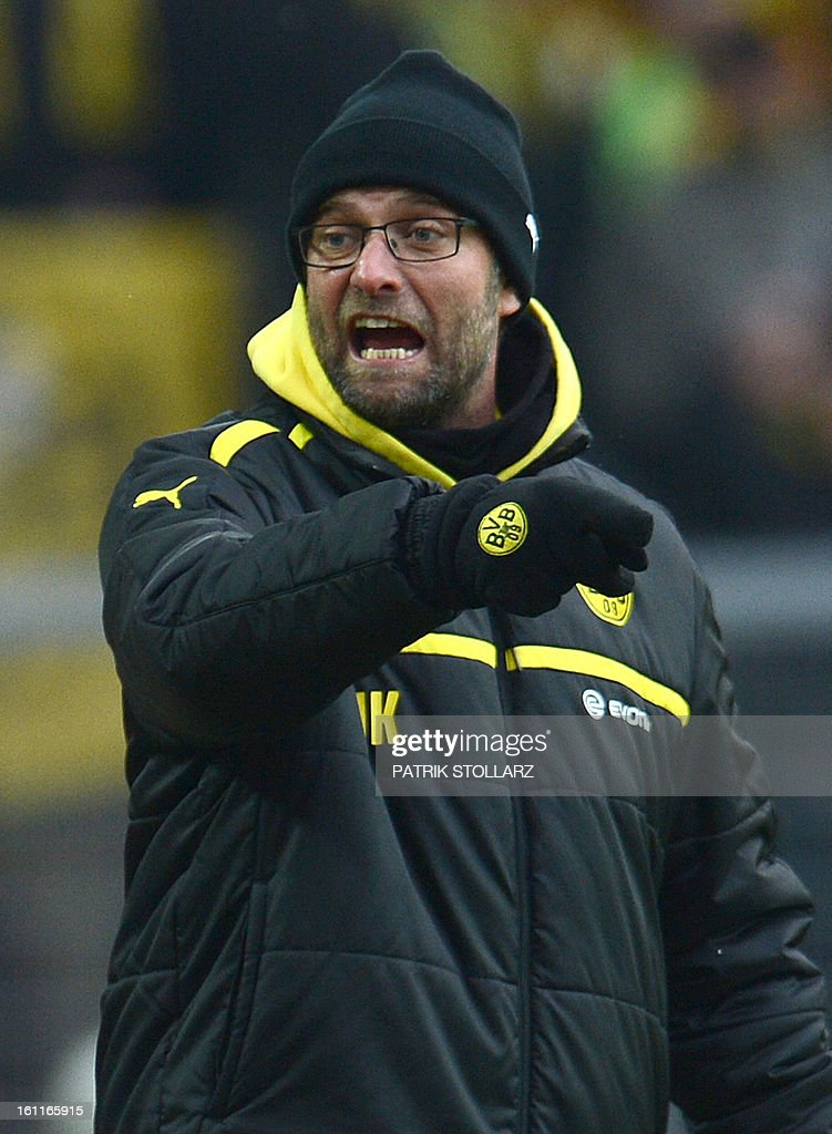 Dortmund's head coach Juergen Klopp reacts during the German first division Bundesliga football match Borussia Dortmund vs Hamburger SV in Dortmund, western Germany, on February 9, 2013. Hamburg won 1-4.