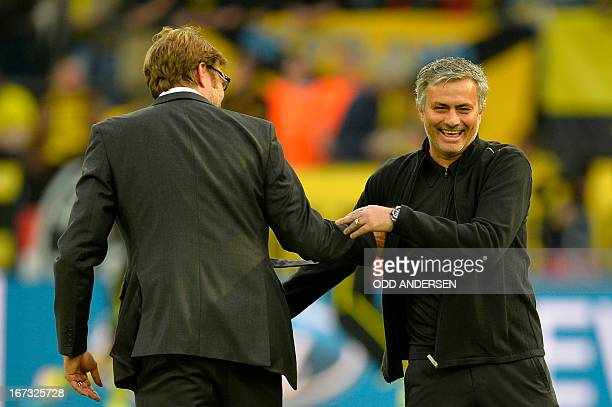 Dortmund's head coach Juergen Klopp shares a laugh with Real Madrid's Portuguese coach Jose Mourinho before the UEFA Champions League semi final...