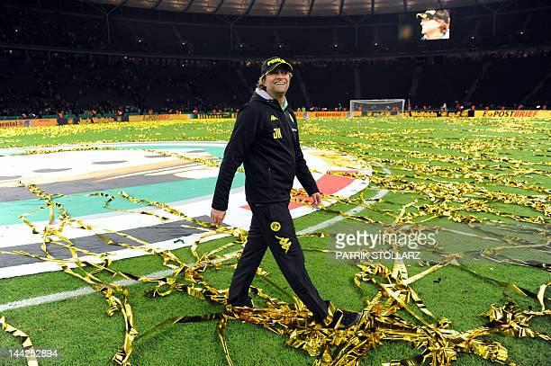 Dortmund's head coach Juergen Klopp walks over the pitch after the German cup DFB Pokal final football match Borussia Dortmund vs Bayern Munich at...