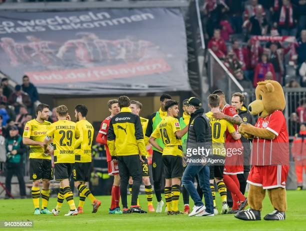 Dortmund's head coach Peter Stoeger passes his team after the German Bundesliga soccer match between Bayern Munich and Borussia Dortmund at the...