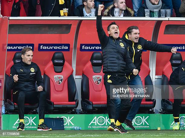 Dortmund's head coach Thomas Tuchel and staff celebrate the third goal for his team during the German first division Bundesliga football match...