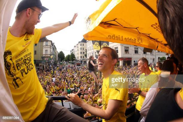 Dortmund's head coach Thomas Tuchel laughs on the bus as players arrive at Borsigplatz during celebrations after winning the German Cup final in...