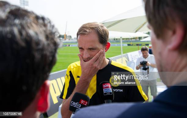 Dortmund's head coach Thomas Tuchel talks to journalists during a press conference following a training session ofGerman Bundesliga soccer club...
