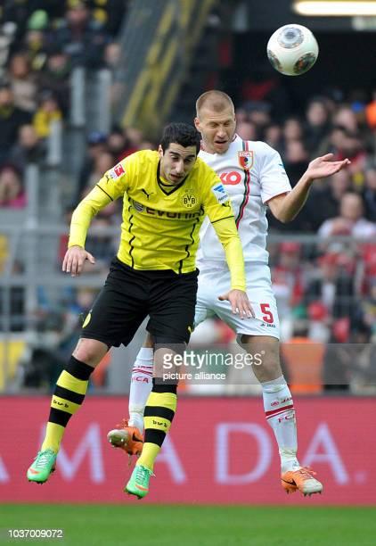 Dortmund's Henrich Mchitarjan vies for the ball with Augsburg's Ragnar Klavan during the German Bundesliga soccer match between Borussia Dortmund and...