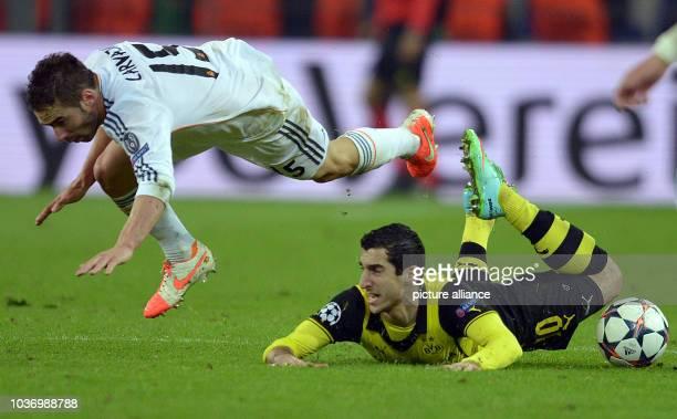 Dortmund's Henrikh Mkhitaryan in action against Madrid's Daniel Carvajal during the UEFA Champions League quarter-final second leg soccer match...