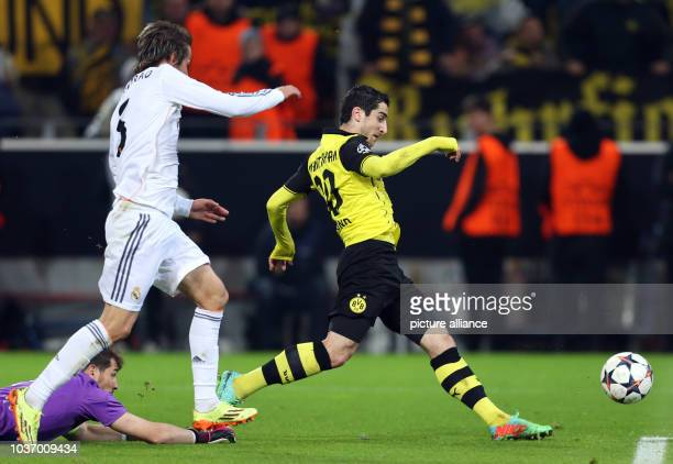Dortmund's Henrikh Mkhitaryan in action against Madrid's Iker Casillas and Fabio Coentrao during the UEFA Champions League quarter-final second leg...