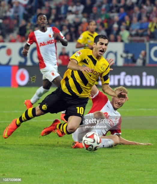 Dortmund's Henrikh Mkhitaryan is fould by Augsburg's Ragnar Klavan during the Bundesliga soccer match betweem FC Augsburg and Borussia Dortmund in...