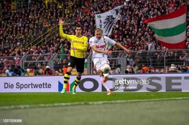 Dortmund's Henrikh Mkhitaryan vies for the ball with Augsburg's Ragnar Klavan during the Bundesliga soccer match between Borussia Dortmund and FC...