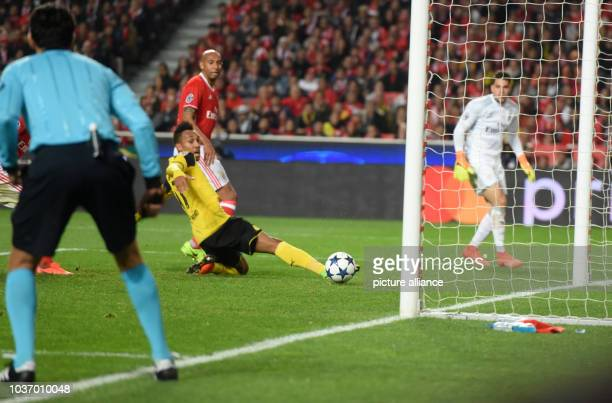 Dortmund's ierreEmerick Aubameyang tries to reach the ball in front of Benfica's goal during the Champions League round of sixteen soccer match...