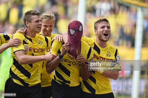 Dortmund's Italian striker Circo Immobile Dortmund's Polish defender Lukasz Piszczek celebrate after Dortmund's Gabonese striker PierreEmerick...