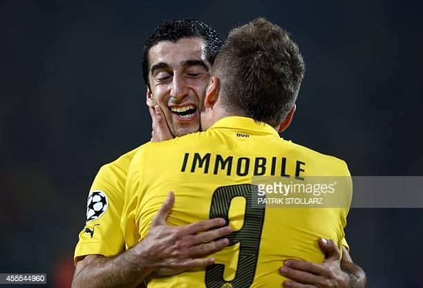 Dortmund's Italian striker Ciro Immobile celebrates scoring the 1-0 goal with Dortmund's Armenian midfielder Henrikh Mkhitaryan during the first leg...