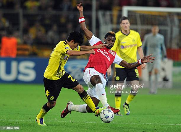 Dortmund's Japanese forward Shinji Kagawa and Arsenal's Cameronian midfielder Alexandre Song vie for the ball during the UEFA Champions League Group...