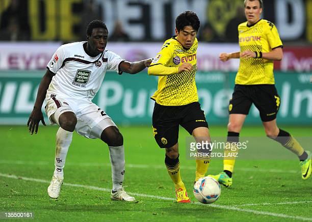 Dortmund's Japanese forward Shinji Kagawa and Kaiserslautern's Brazilian defender Rodnei vie for the ball during the German first division Bundesliga...