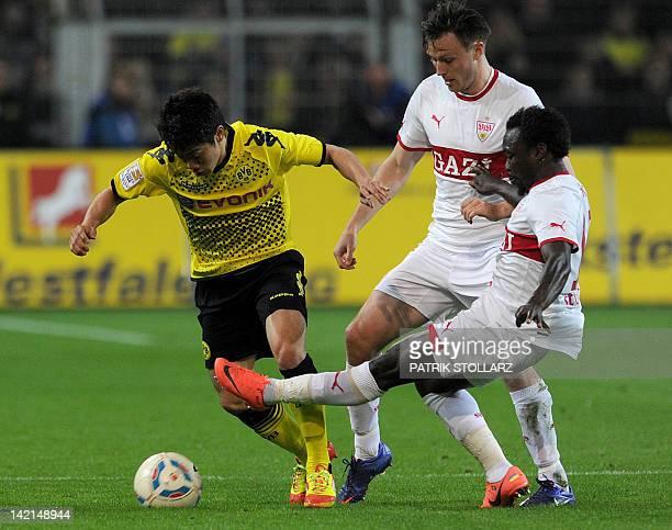 Dortmund's Japanese forward Shinji Kagawa and Stuttgart's Ivorian defender Arthur Boka vie for the ball during during the German first division...