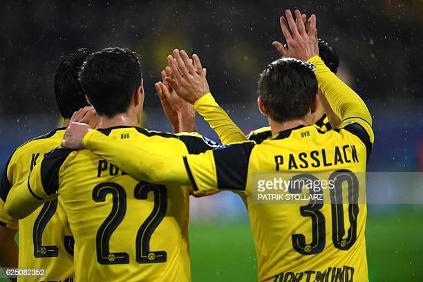 Dortmund's Japanese midfielder Shinji Kagawa and his teammates celebrate during the Champions League football match between Borussia Dortmund and...