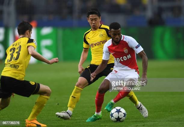 Dortmund's Japanese midfielder Shinji Kagawa and Monaco's French midfielder Thomas Lemar vie for the ball during the UEFA Champions League 1st leg...