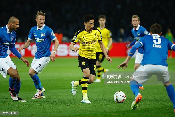 Dortmund's Japanese midfielder Shinji Kagawa attempts to get past Hertha's midfielder Niklas Stark with the ball during the German Cup semifinal...