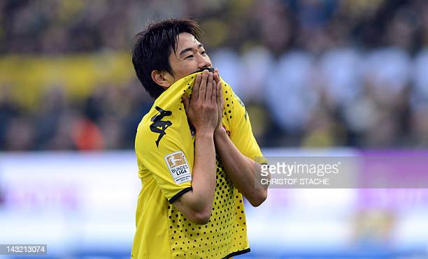 Dortmund's Japanese midfielder Shinji Kagawa celebrates after scoring during the German first division Bundesliga football match Borussia Dortmund vs...
