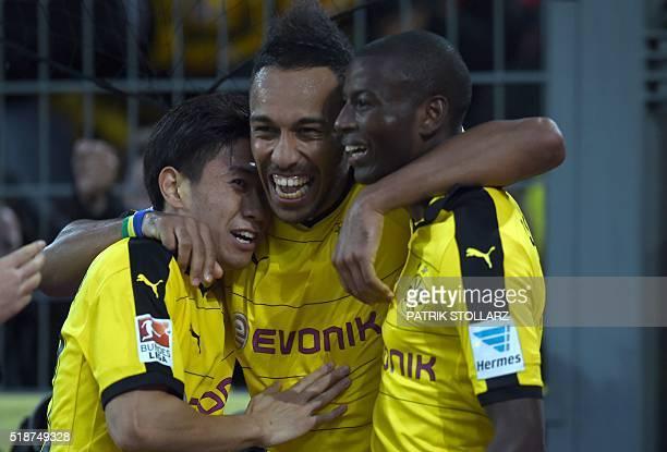 Dortmund's Japanese midfielder Shinji Kagawa Dortmund's Gabonese striker PierreEmerick Aubameyang and Dortmund's Columbian striker Adrian Ramos...