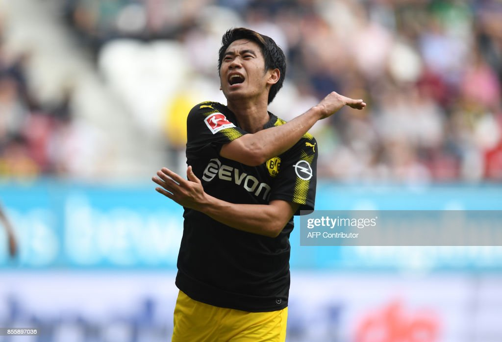 Dortmund's Japanese midfielder Shinji Kagawa reacts after missing a chance during the German first division Bundesliga football match between FC Augsburg and Borussia Dortmund in Augsburg, southern Germany on September 30, 2017. / AFP PHOTO / Christof