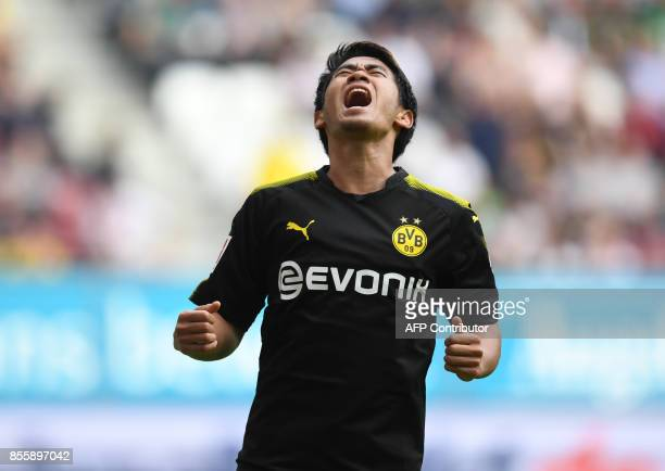 Dortmund's Japanese midfielder Shinji Kagawa reacts after missing a chance during the German first division Bundesliga football match between FC...