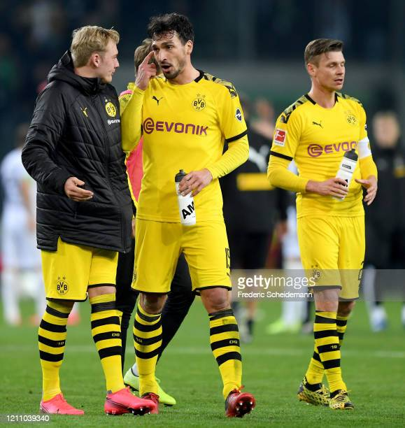 Dortmund's Julian Brandt Dortmund's Mats Hummels and Dortmund's Lukasz Piszczek after the Bundesliga match between Borussia Moenchengladbach and...