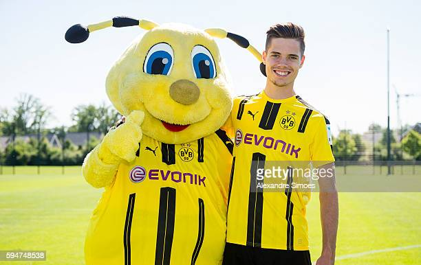 Dortmund's Julian Weigl poses during with mascot Emma at the team presentation of Borussia Dortmund on August 17 2016 in Dortmund Germany
