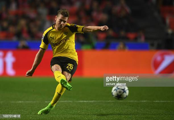 Dortmund's Lukasz Piszczek plays the ball during the first leg of the Champions League quarter final knockout match between the Portuguese champions...