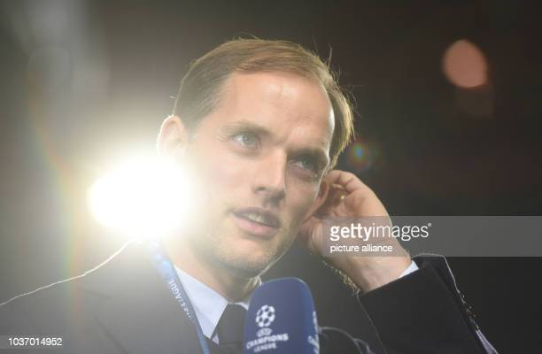 Dortmund's manager Thomas Tuchel gives an interview after the first leg of the Champions League quarter final knockout match between the Portuguese...