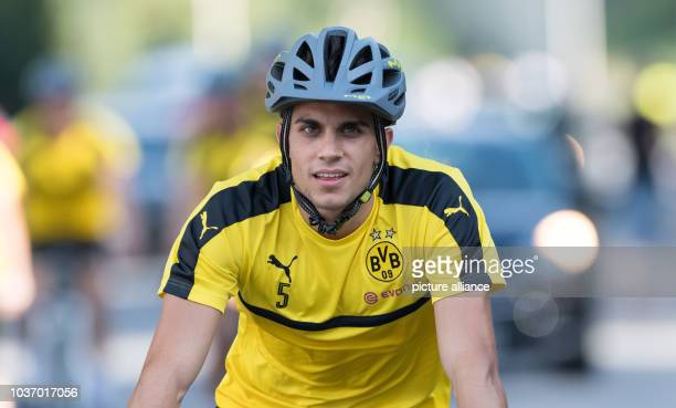 Dortmund's Marc Bartra arriving by bike for the first training session in Bad Ragaz, Switzerland, 3 August 2016. PHOTO: GUIDO KIRCHNER/dpa | usage...