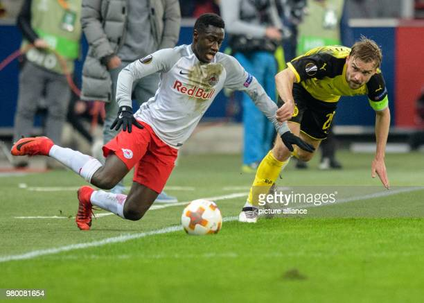 Dortmund's Marcel Schmelzer and Salzburg's Diadie Samassekou vie for the ball during the UEFAEuropa League round of 16 second leg soccer match...