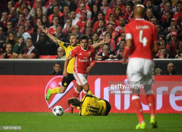 Dortmund's Marcel Schmelzer gestures after a foul commmited by Benfica's Eduarado 'Toto' Salvio on Marco Reus during the Champions League round of...