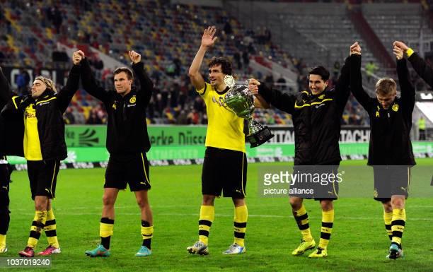 Dortmund's Marcel Schmelzer Kevin Grosskreutz Mats Hummels Nuri Sahin and Jakub Blaszczykowski after winning the Winter Cup at Esprit Arena in...