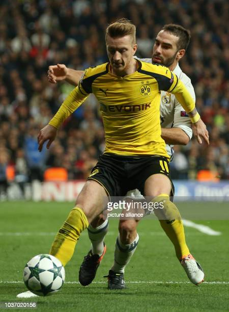 Dortmund's Marco Reus and Daniel Carvajal of Madrid vie for the ball during the Champions League football match between Real Madrid and Borussia...
