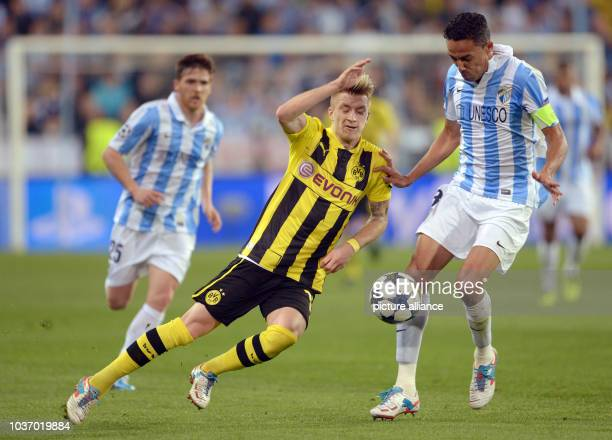 Dortmund's Marco Reus and Malaga's Weligton vie for the ball during the UEFA Champions League quarter final first leg soccer match between Malaga CF...