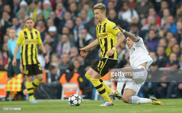 Dortmund's Marco Reus and Real's Angel di Maria vie for the ball during the UEFA Champions League semi final second leg soccer match between Borussia...