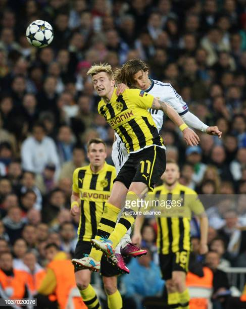Dortmund's Marco Reus and Real's Luka Modric vie for the ball during the UEFA Champions League semi final second leg soccer match between Borussia...