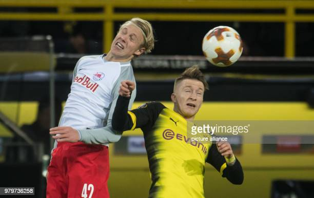 Dortmund's Marco Reus and Salzburg's Xaver Schlager battle for a header during the UEFA Europa League round of 16 soccer match between Germany's...