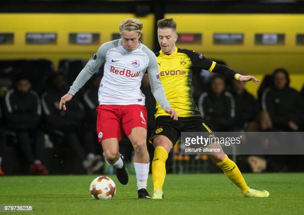 Dortmund's Marco Reus and Salzburg's Xaver Schlager battle for the ball during the UEFA Europa League round of 16 soccer match between Germany's...