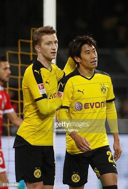 Dortmund's Marco Reus and Shinji Kagawa celebrate a goal during the Bundesliga soccer match between Borussia Dortmund and FSV Mainz 05 at the...