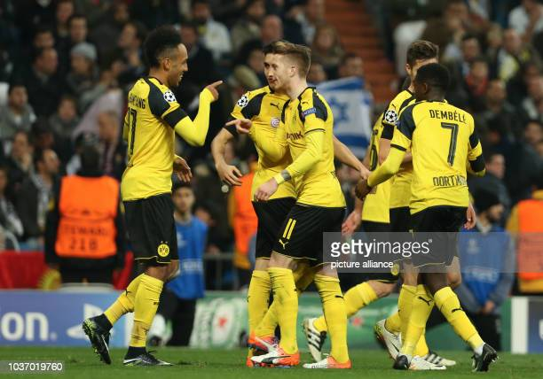 Dortmund's Marco Reus celebrates his 2-2 equaliser with teammate Pierre-Emerick Aubameyang during the UEFAChampions League group phase soccer match...
