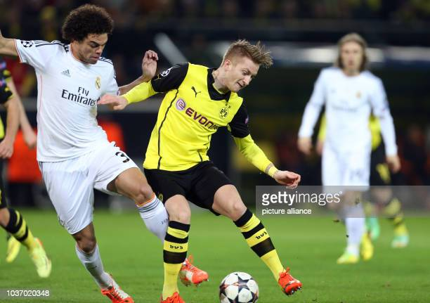 Dortmund's Marco Reus in action against Madrid's Pepe during the UEFA Champions League quarter-final second leg soccer match between Borussia...