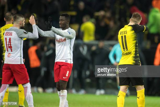 Dortmund's Marco Reus turns away while Salzburg's Valon Berisha and Diadie Samassekou celebrate their victory after the final whistle of the UEFA...