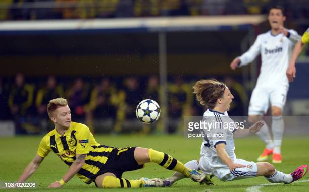 Dortmund's Marco Reus vies for the ball with Madrid's Luka Modric during the UEFA Champions League semi final first leg soccer match between Borussia...