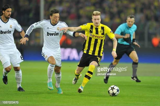 Dortmund's Marco Reus vies for the ball with Madrid's Mesmut Oezil during the UEFA Champions League semi-final first leg soccer match between...