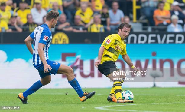 Dortmund's Mario Goetze plays against Berlin's Niklas Stark during the Bundesliga soccer match between Borussia Dortmund and Hertha BSC Berlin at the...
