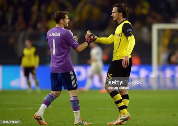 Dortmund's Mats Hummels and Madrid's Iker Casillas shake hands after the UEFA Champions League quarter-final second leg soccer match between Borussia...