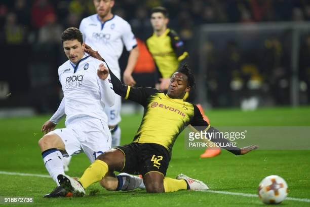 Dortmund's Michy Batshuayi and Bergamo's Mattia Caldara vie for the ball during the UEFA Europa League round of 32 first leg football match of...